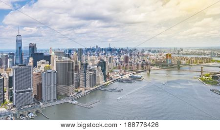 Stunning aerial view of lower Manhattan Skyline with Brooklyn Bridge on a sunny day, New York City