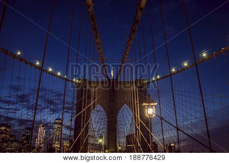 famous Brooklyn Bridge in the evening during the blue hour with the Manhattan skyline in the back, New York City