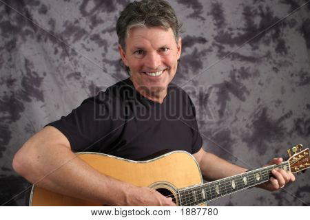 Stock Photo Of A Mature Male Guitarist 6