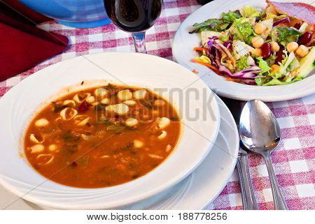 Bowl of minestrone soup with garden salad