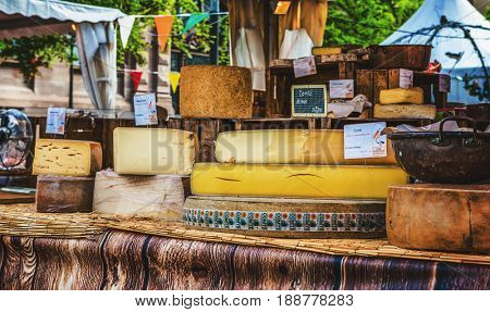 STRASSBOURG, FRANCE- CIRCA MARCH, 2017: Assorted speciality regional cheeses in Strasbourg, France displayed on an open air stall at a street market showing the cross sections of the wheels