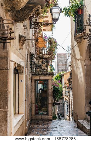 TAORMINA, SICILY, ITALY - APRIL 27, 2017: Narrow street in city of Taormina on the island of Sicily