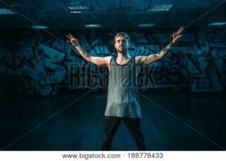 Male rapper in dance studio, trendy lifestyle
