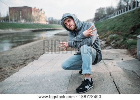 Male rapper posing on the street, urban dancing
