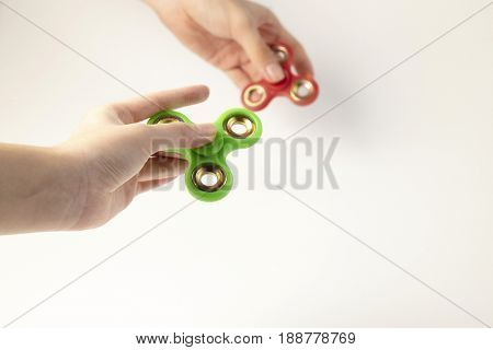 fidget spinner on the girl and man's hand