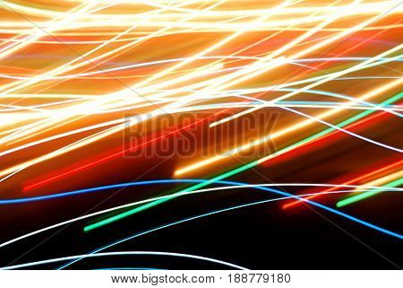 Streaks of colorful lights in motion
