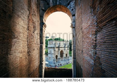 Archway in Colosseum with Arch of Constantine, the world known landmark and the symbol of Rome, Italy.