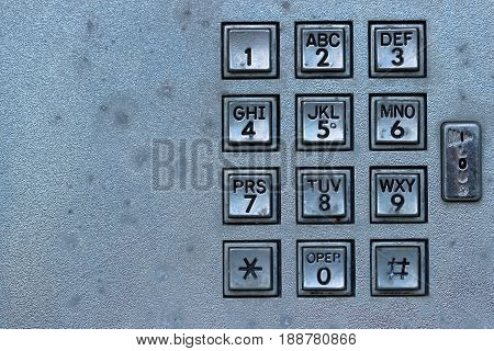 Retro telephone booth key pad with copy space
