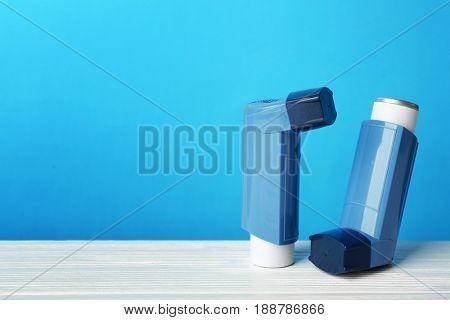 Asthma inhalers on blue background