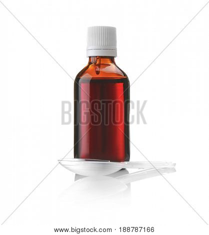 Bottle with cough syrup and measuring spoon on white background