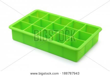 Green silicone ice cube tray isolated on white