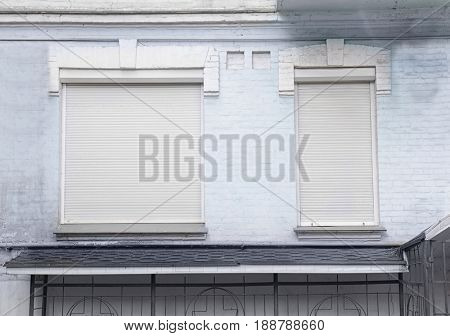 Windows with closed blinds on old building