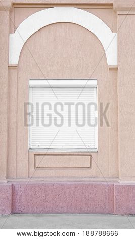 Window with closed blinds on old building