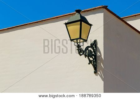 Ð?ld fashioned outdoor lamp on white wall arhitecture detail. Mijas town. Spain