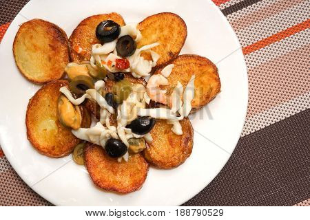 Potatoes and assorted seafood