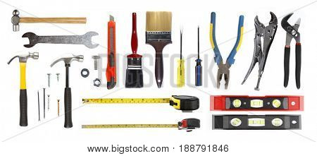Assortment of tools on plain background
