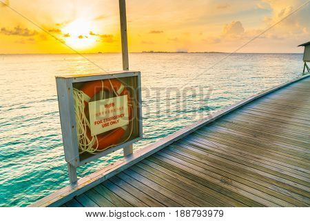 lifebouy or safety ring in maldives resort at the sunrise time