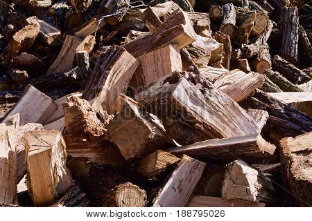 A closeup shows the pieces of cut and split oak logs.