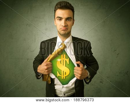 Businessman tearing off his shirt with dollar sign on chest concept on background