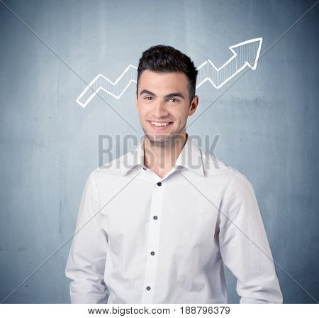 A handsome sales guy standing in front of a blue urban concrete wall with illustration of white graph chart arrows cocncept
