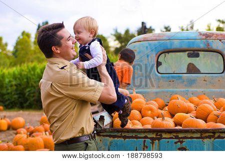 Toddler and dad at a pumpkin farm