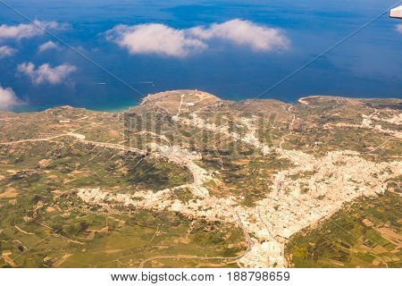 Aerial  View of the island of Gozo and Malta from the cabin of the aircraft