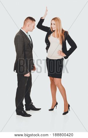 Pregnant businesswoman arguing with her partner