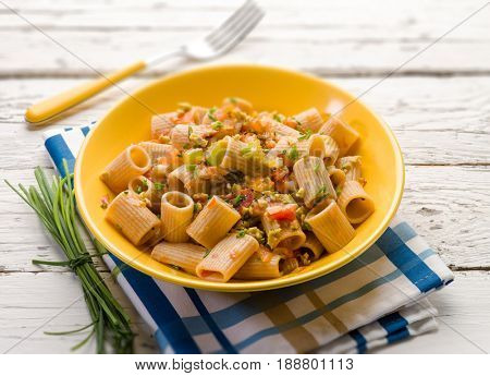 integral pasta with chive tomatoes and minced olives; selective focus