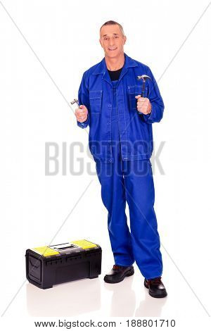 Worker with toolbox showing his wrench and hammer