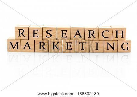 Wooden cubes with text RESEARCH MARKETING on white background
