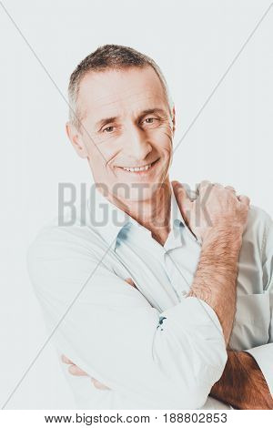 Good looking man with folded arms