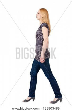 back view of walking woman . going blonde gir in motion. Rear view people collection.  backside view of person. Isolated over white background.