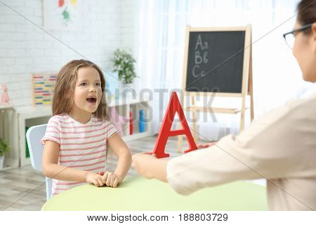 Little girl with teacher on private lesson