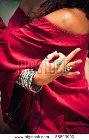 closeup of woman hand in yoga symbolic gesture mudra outdoor