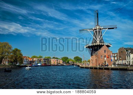 Harlem cityscape with windmill De Adriaan on Spaarne river. Harlem,  Netherlands