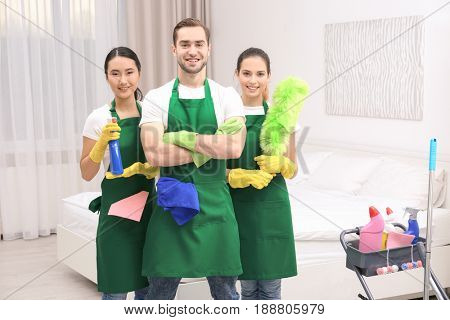 Cleaning service team at work in bedroom