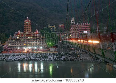 Temples in Laxman Jhula at the river Ganges in India Asia by night