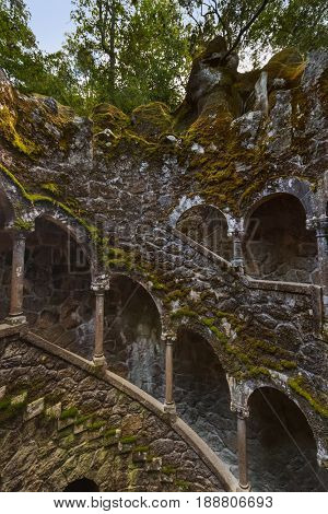 Initiation Well in Castle Quinta da Regaleira - Sintra Portugal - travel background