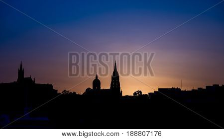 silhouette of church building at sunset in Gozo island. Malta.