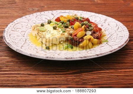 Baked feta cheese with cherry tomatoes. Low carb healthy eating concept.