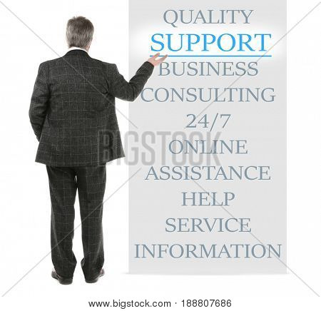 Help desk concept. Man pointing on word SUPPORT against white background