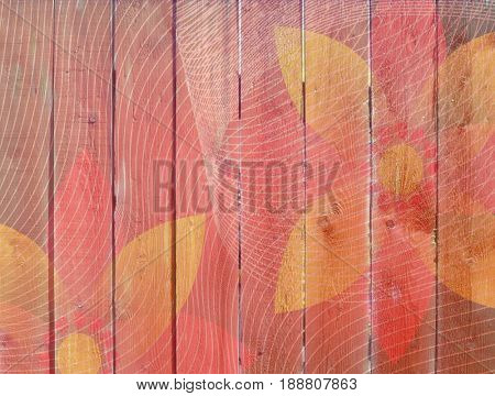 Closeup of pink wooden plank fence overlaid with flower pattern