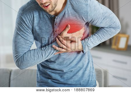 Heart attack concept. Man suffering from chest pain, closeup