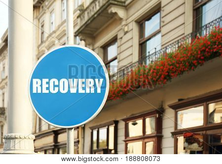 Rehabilitation concept. Signboard with word RECOVERY on street