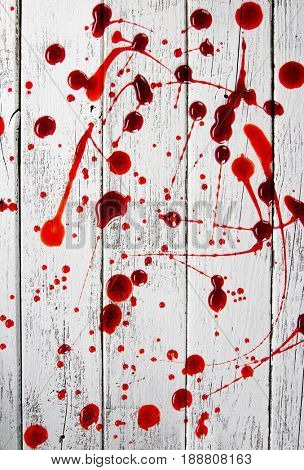 Bloody spots on old wooden background. Murder or criminal concept.