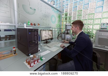 ST. PETERSBURG, RUSSIA - APRIL 28, 2017: Researcher of VMPAUTO enterprise in the laboratory during the press tour to the production of lubricants. The company exports products to 35 countries