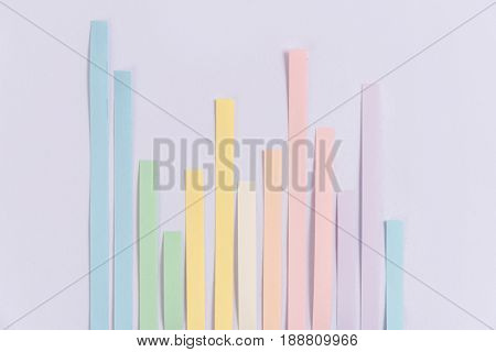 Image of business graphics diagrama isolated over grey table background.