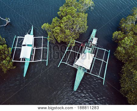 Aerial top view of pump boats in mangrove forest. Palawan May 2017