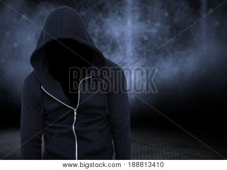 Digital composite of Anonymous criminal against dark background