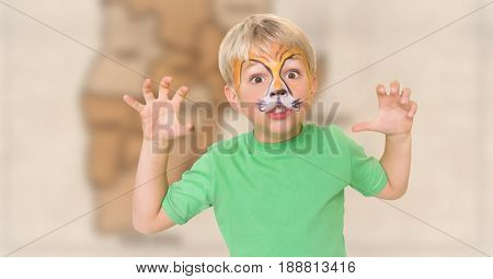 Digital composite of Boy with facepaint growling against blurry brown map